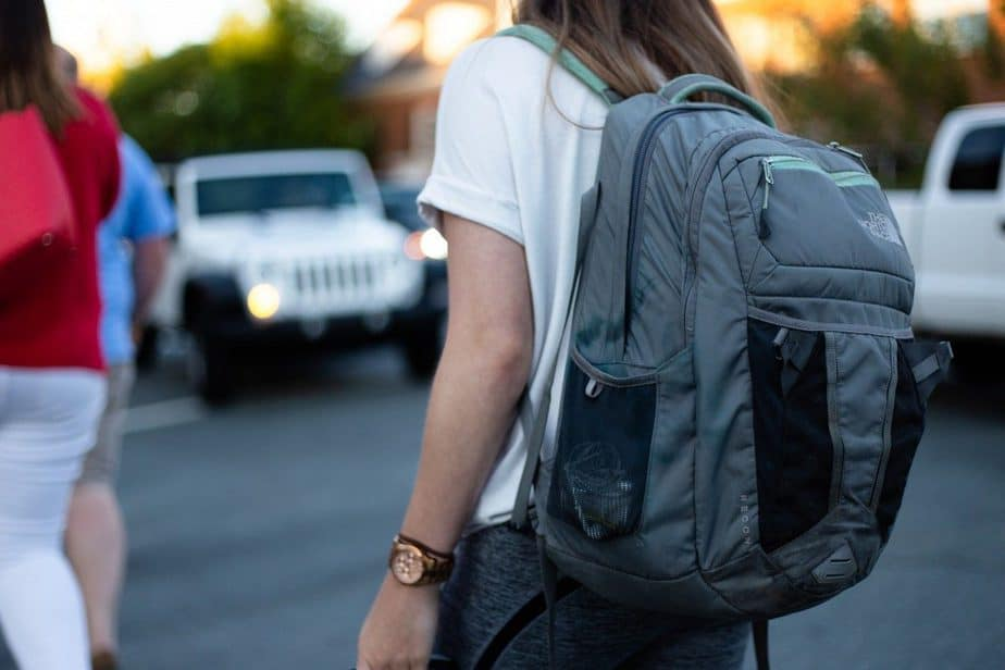 woman using gray backpack