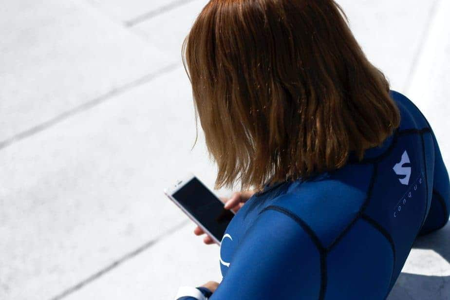 woman holding smartphone during daytime